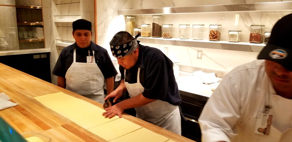 Fresh pasta is made on site in view of the guests.