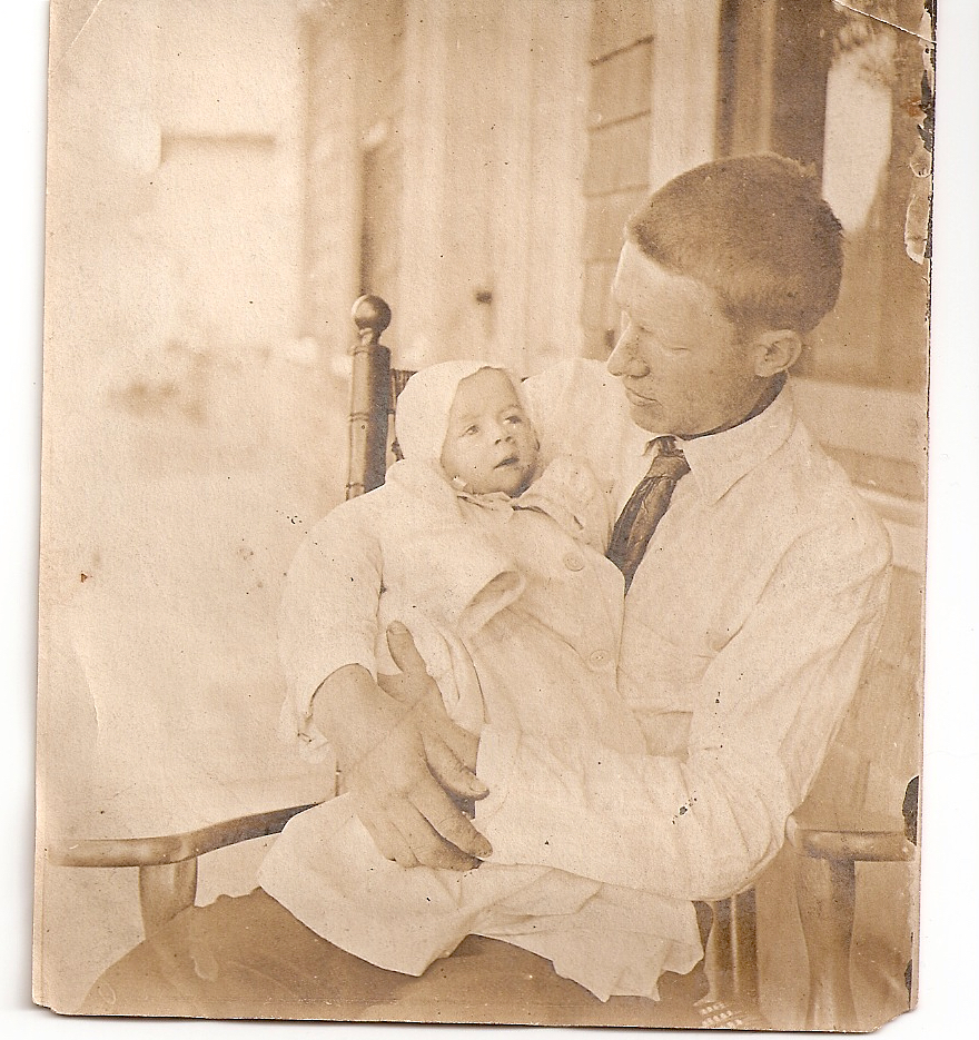 Will Ryder holding his son Philip, 1910