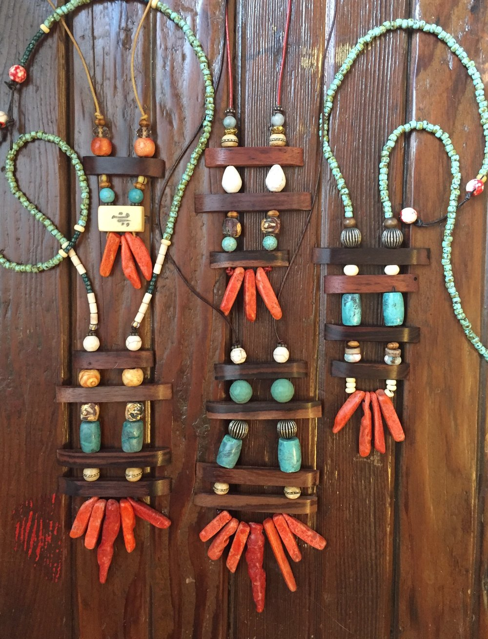 Southwest style: faux coral, turquoise glass & howlite, organic wood on leather cord