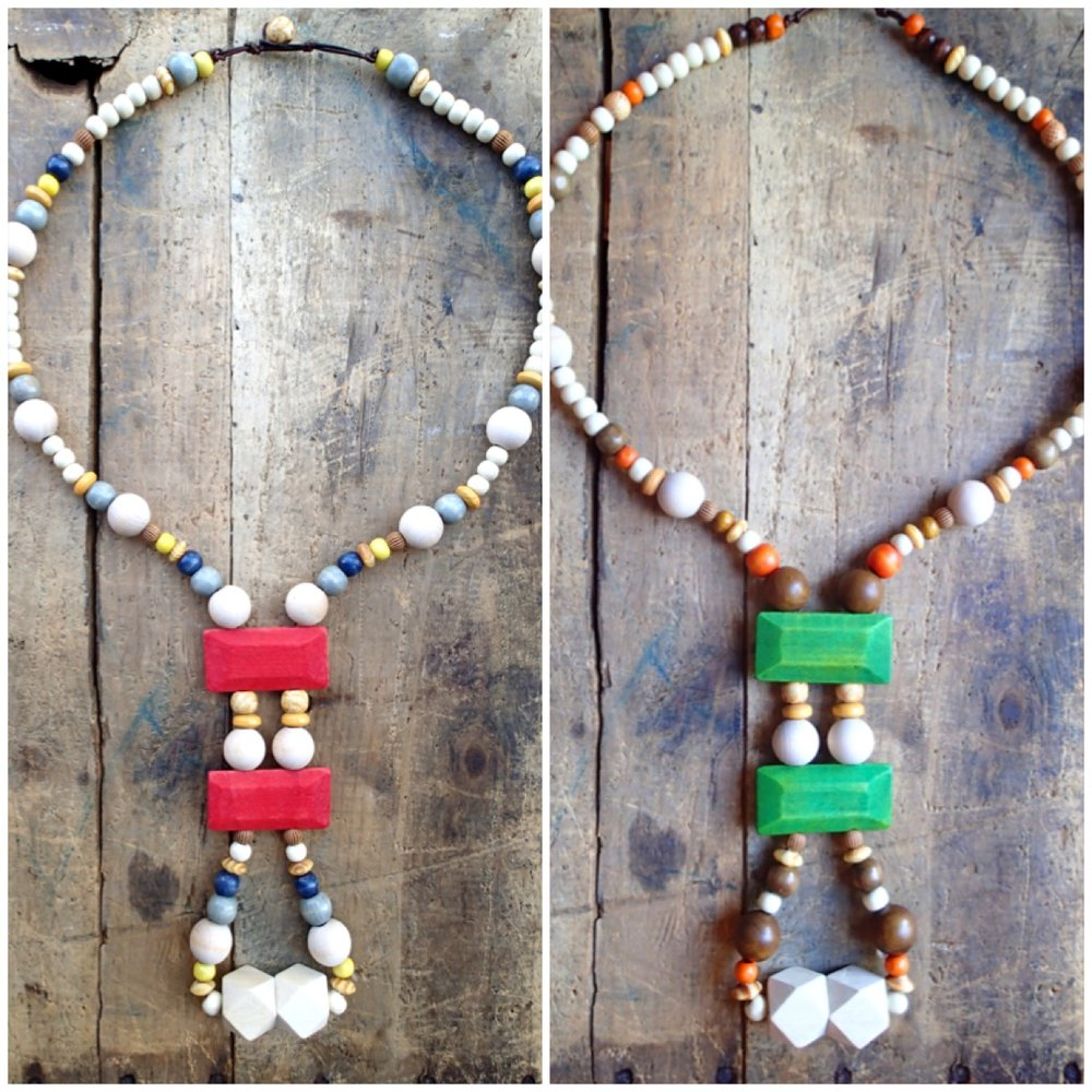 Chunky wood necklaces with various colored accents.