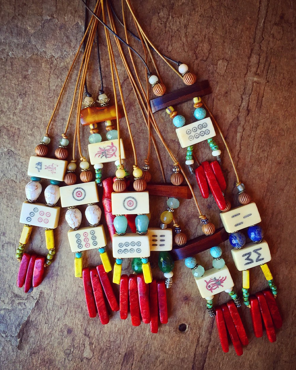 Vintage bone Mahjong, coral, glass & wood beads on distressed leather cord.