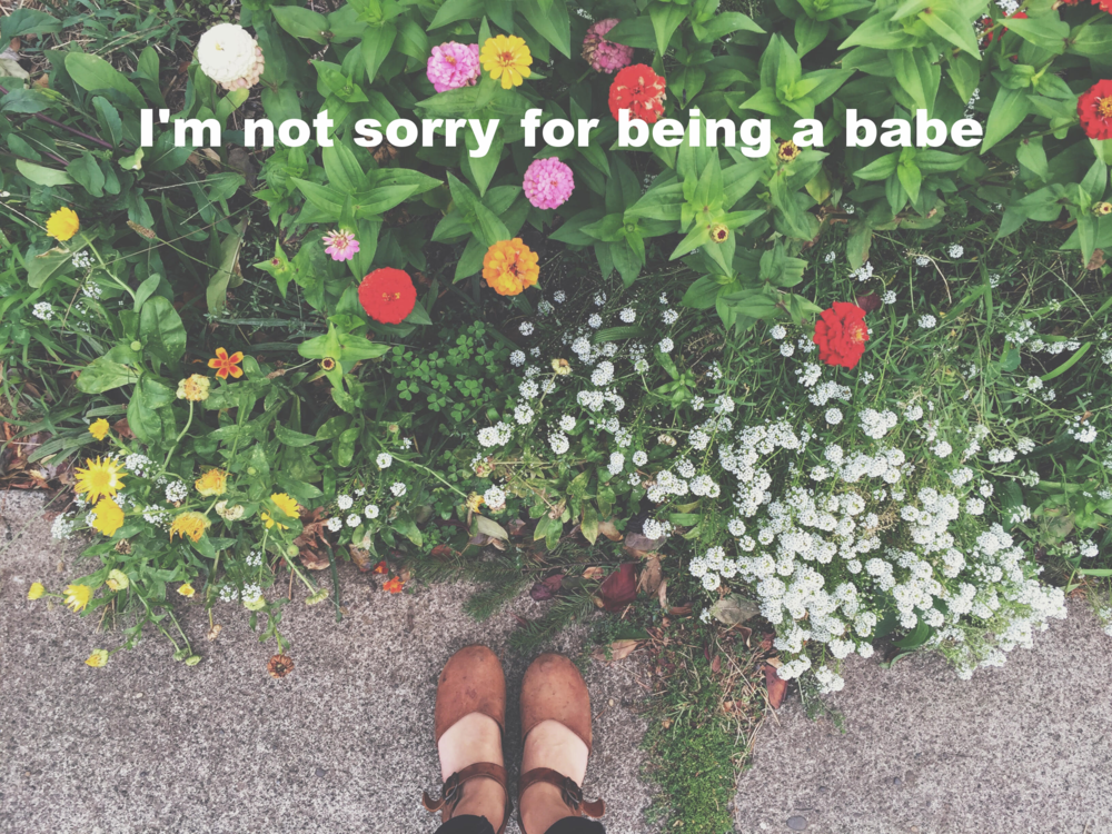 "Toni January 3 2016 Image of a flowerbed. ""I'm not sorry for being babe"" is overlaid."