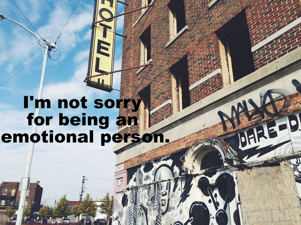 "Alex January 14 2016 City image of a red brick-sided building with a yellow pop-out ""HOTEL"" sign and graffiti towards the bottom. ""I'm not sorry for being an emotional person"" is overlaid."