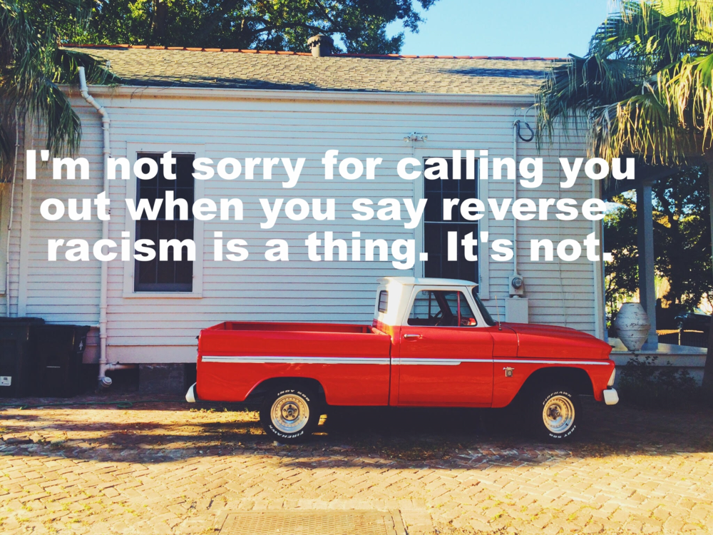 "Lindsay December 30 2015 Fire engine red pick up truck with a white stripe in front of a white building. ""I'm not sorry for calling you out when you say reverse racism is a thing. It's not"" is overlaid."