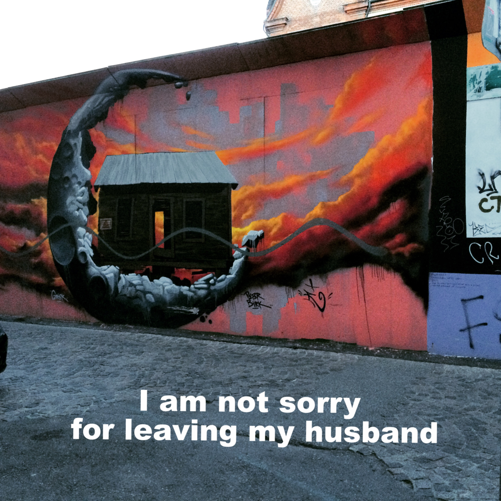 "Anonymous January 19 2016 Mural of a cabin being cradled by the moon and orange and pink clouds. ""I'm not sorry for leaving my husband"" is overlaid."