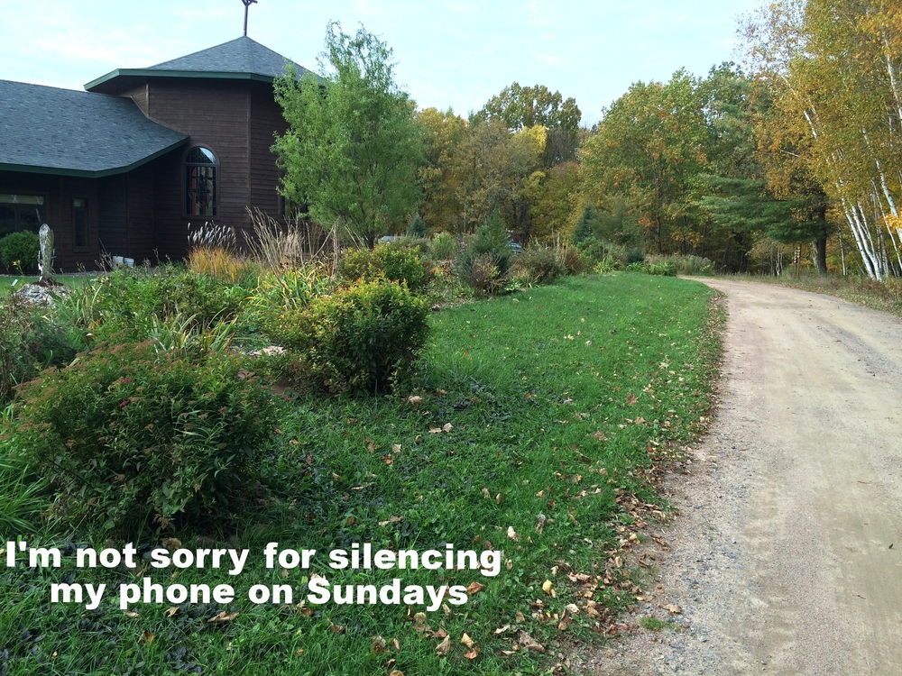 "Anonymous January 25 2016 Gravel path surrounded by trees in autumn. A brown church building is off to the left. ""I'm not sorry for silencing my phone on Sundays"" is overlaid."