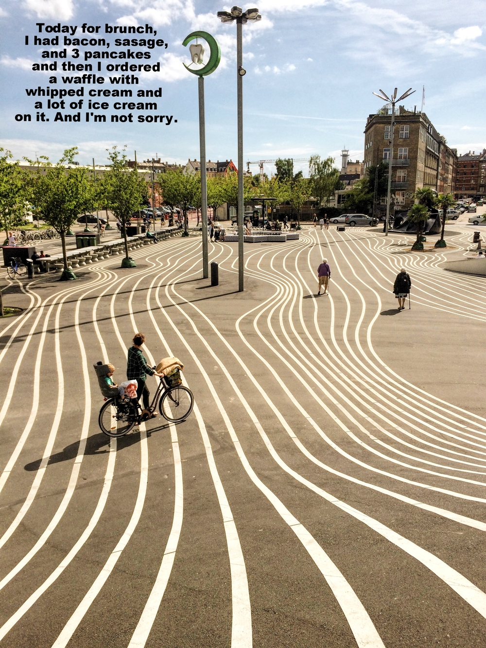 "Zoe January 10 2016 Image of a public art project, where squiggly white lines indicating lanes are drawn whimsically on pavement. A mother on a bicycle with a child in the back ride through the project, and several older women walking with canes walk through. ""Today for brunch I had bacon, sausage, and 3 pancakes, and then I ordered a waffle with whipped cream and a lot of ice cream on it. And I'm not sorry"" is overlaid."