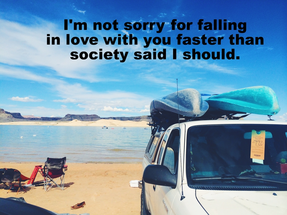 "Ezra Marie March 29 2016 Image of a white pickup truck with two kayaks strapped to a rack on the top. Behind the truck is a wide blue lake, and beyond that are several gray rock formations. ""I'm not sorry for falling in love with you faster than society said I should"" is overlaid."