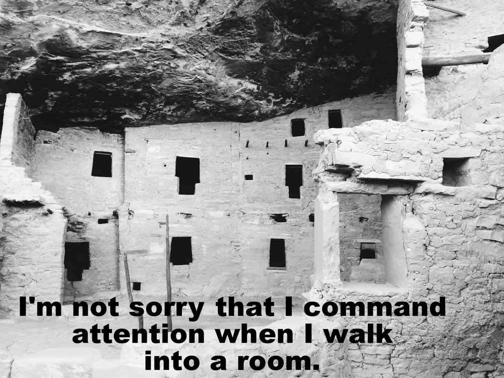 "Anonymous April 25 2016 Black and white image of a crumbling stone/mud dwelling built into the side of a rockface. ""I'm not sorry that I command attention when I walk into a room"" is overlaid."
