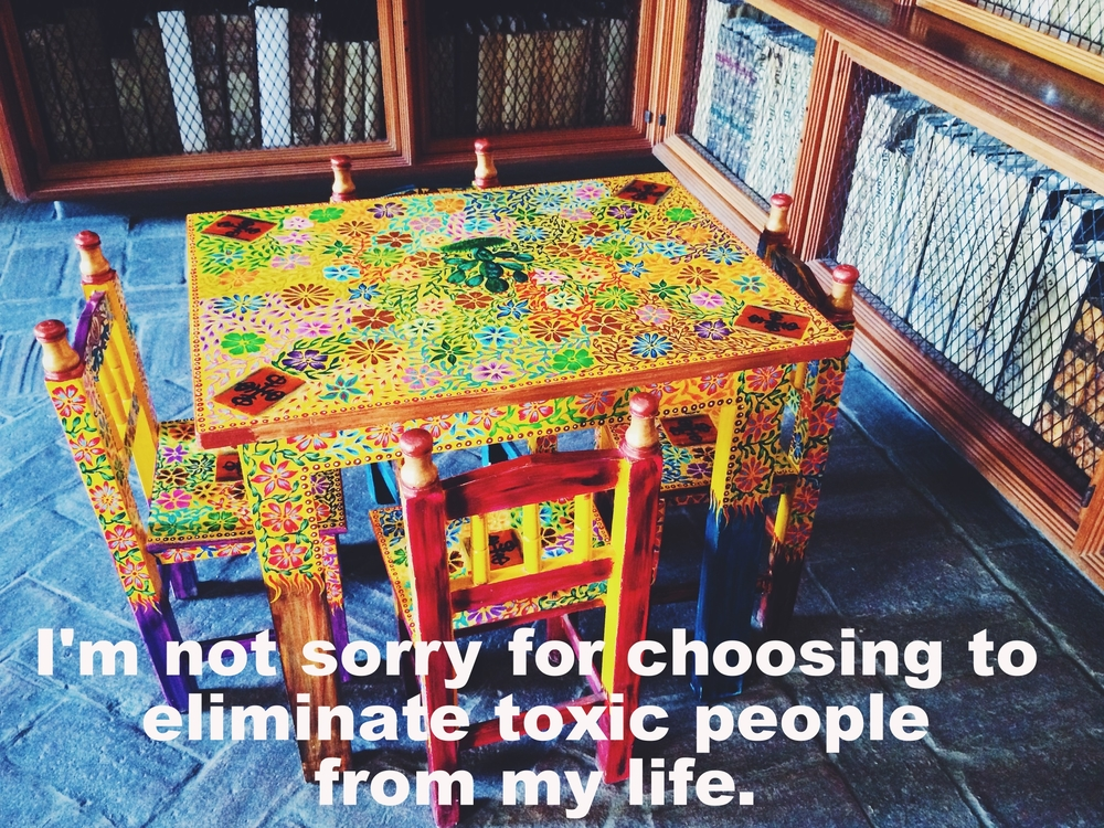 "Julie Ann June 2 2016 Image of a brightly painted child-sized table. Flowers are painted on the table and the four small chairs that sit around it. There are shelves of books surrounding the table and a slate-blue stone floor.  ""I'm not sorry for choosing to eliminate toxic people from my life"" is overlaid."