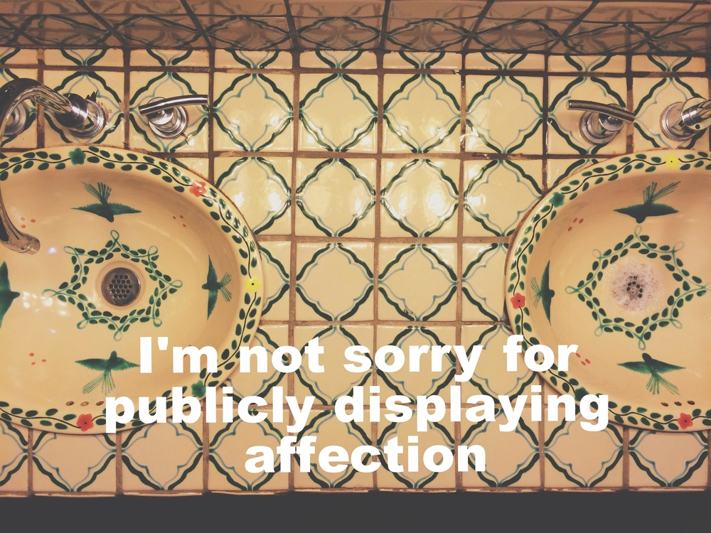 "Anonymous June 27 2016 Image of two ceramic tiled sinks, shot from above. The tiles between the sinks are painted with green square patterns. The sinks are patterned with green birds. ""I'm not sorry for publicly displaying affection"" is overlaid."