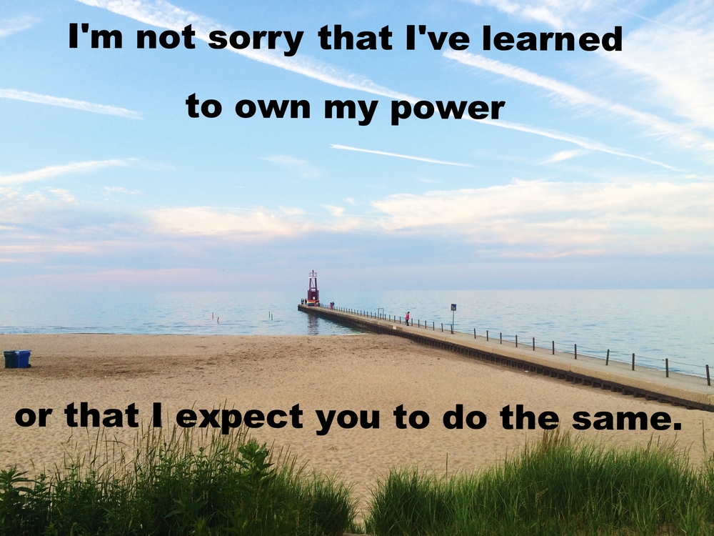 "Anonymous June 24 2016 Image of a sandy beach and a dock stretching outward. An almost indistinguishable line separates the light water from the sky with clouds and streaks of white. Tall grass foregrounds the picture. ""I'm not sorry that I've learned to own my power or that I expect you to do the same"" is overlaid."