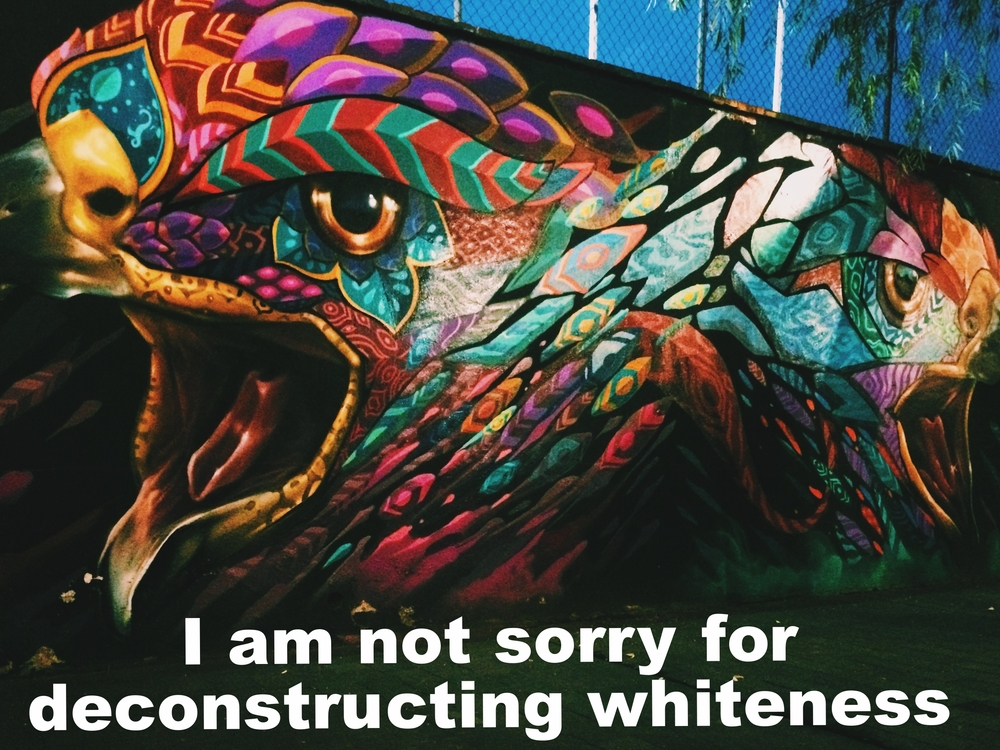 "Matt July 6 2016 Image of a mural of a colorful and fierce two headed eagle with its mouths open.  ""I am not sorry for deconstructing whiteness"" is overlaid."