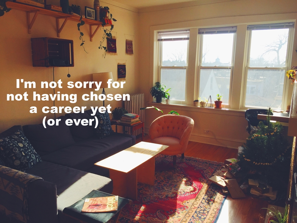 "Anonymous July 6 2016 Image of a living room in a small apartment. Sunlight streams in and falls in a slat across the middle of the frame. A small Christmas tree sits to the right of the frame, with present underneath. ""I'm not sorry for not having chosen a career yet (or ever)"" is overlaid."