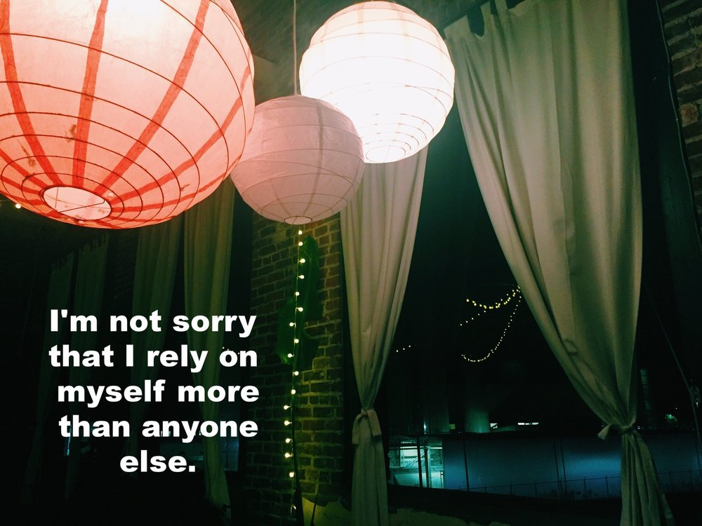 "Anonymous September 29 2016 Image of several colorful paper lanterns hung from the ceiling in a brick-walled room. ""I'm not sorry that I rely on myself more than anyone else"" is overlaid."