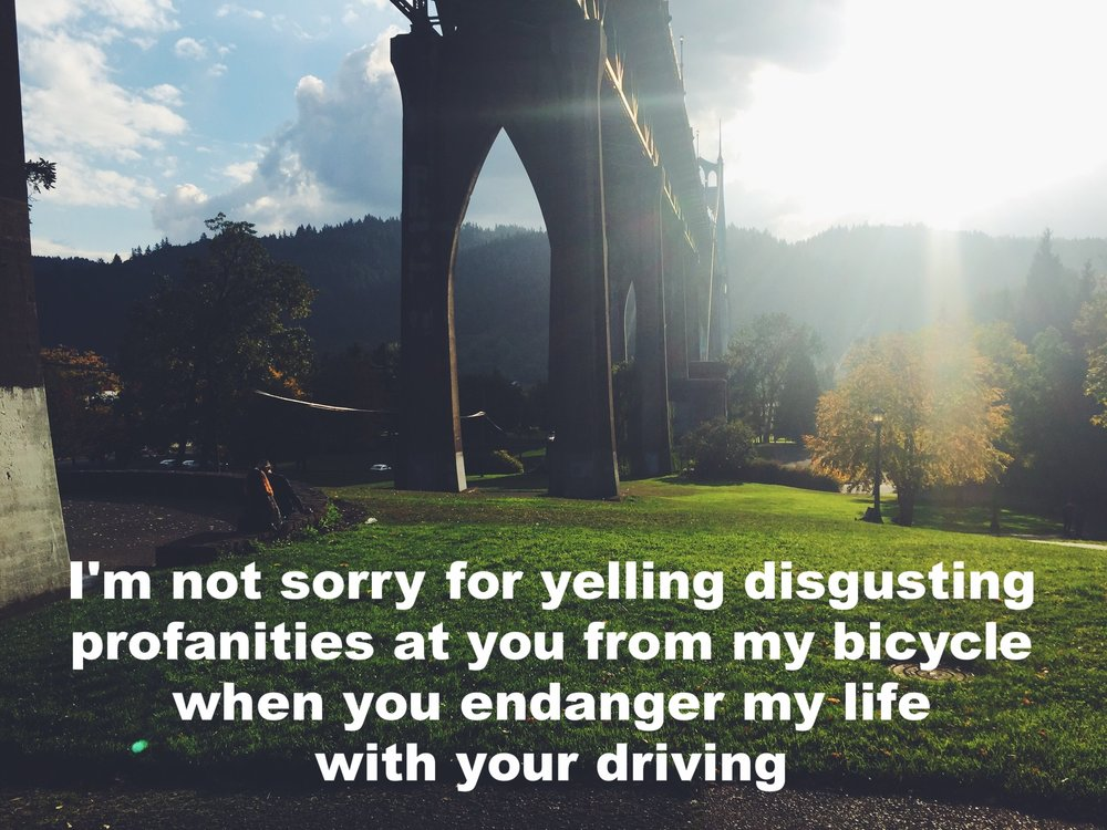 "Jess September 19 2016 Image of a park underneath a bridge. The sun shines directly over a mountain in the background and illuminates the grass in the foreground. ""I'm not sorry for yelling disgusting profanities at you from my bicycle when you endanger my life with your driving"" is overlaid."