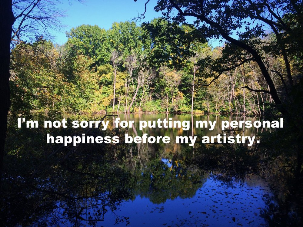 """Anonymous October 13 2016 Image of a pond in autumn with trees surrounding it. The water is dark and reflects the trees. """"I'm not sorry for putting my personal happiness before my artistry"""" is overlaid."""