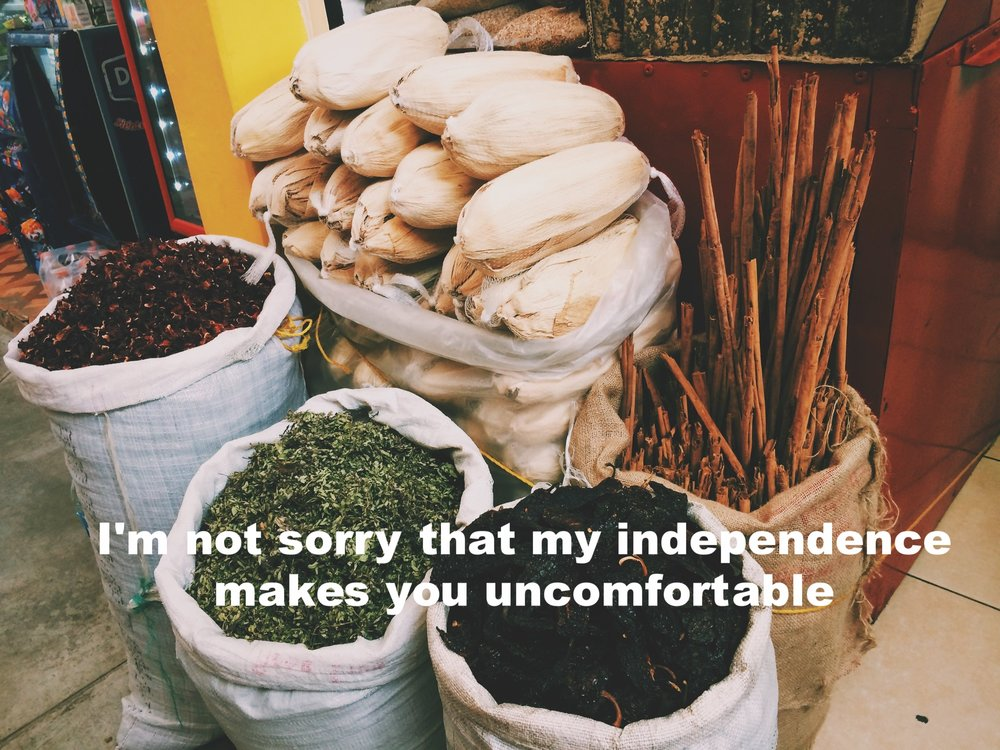 """Anonymous October 4 2016 Image of tall sacks of dried chili peppers, herbs, long sticks of cinnamon, and corn husks. """"I'm not sorry that my independence makes you uncomfortable"""" is overlaid."""