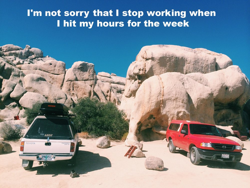 "Anonymous August 16 2016 Image of two trucks, one white and one red, parked in the sand at the base of several rock formations. ""I'm not sorry that I stop working when I hit my hours for the week"" is overlaid."
