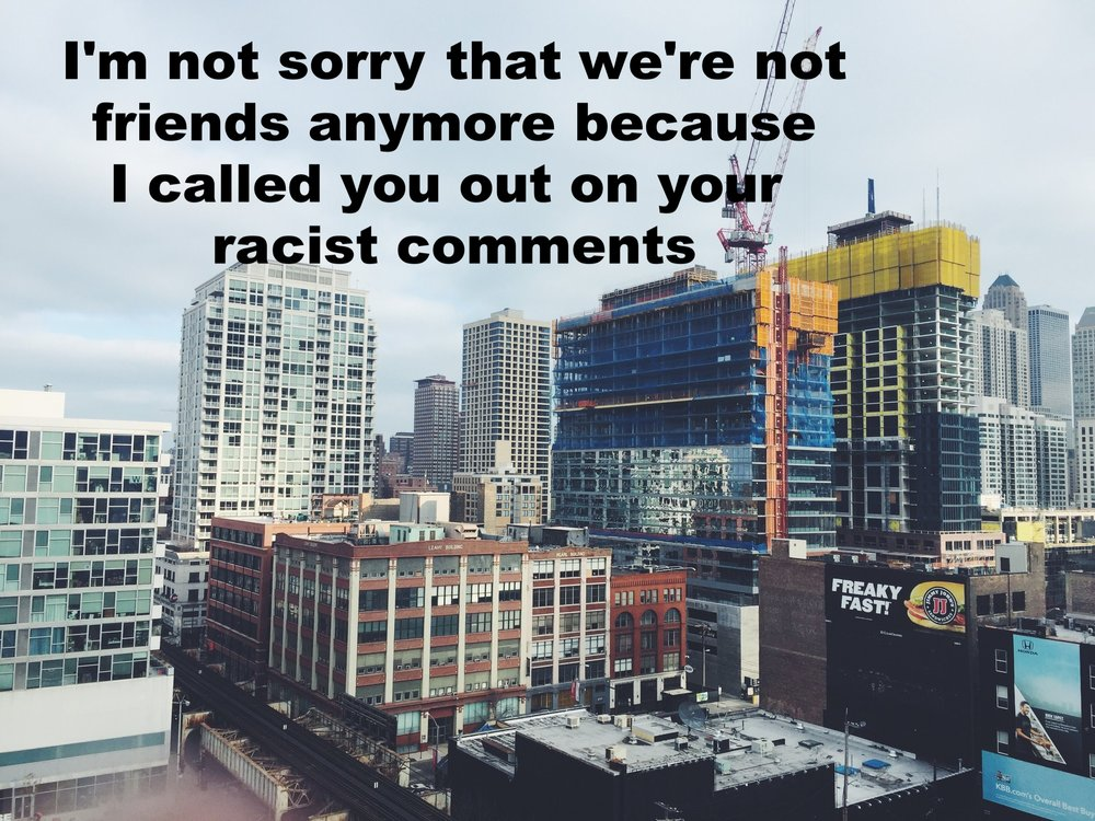 "Anonymous December 7 2016 Image of a many large buildings close together in a large city. ""I'm not sorry that we're not friends anymore because I called you out on your racist comments"" is overlaid."