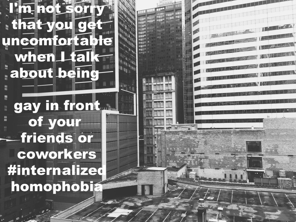 "Anonymous January 22 2017 Black and white image of several large buildings. ""I'm not sorry that you get uncomfortable when I talk about being gay in front of your friends or coworkers #internalizedhomophobia"" is overlaid."