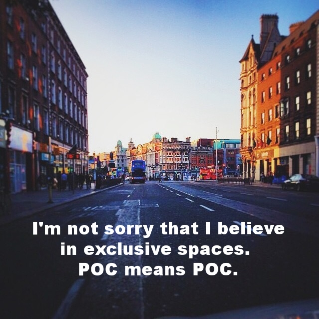 "Anonymous February 14 2017 Streetview image of a city with wide streets. Storefronts blur as the settling light hits the buildings. ""I'm not sorry that I believe in exclusive spaces. POC means POC"" is overlaid. Photo credit: Lindsay Kopit"
