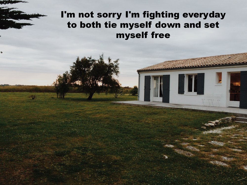 "Hannah March 29 2017 Image of a single story white home with blue shutters . There is a large grassy yard in front of it, and one short tree. ""I'm not sorry I'm fighting every day to both tie myself down and set myself free"" is overlaid. Photo by Laura Harrington."