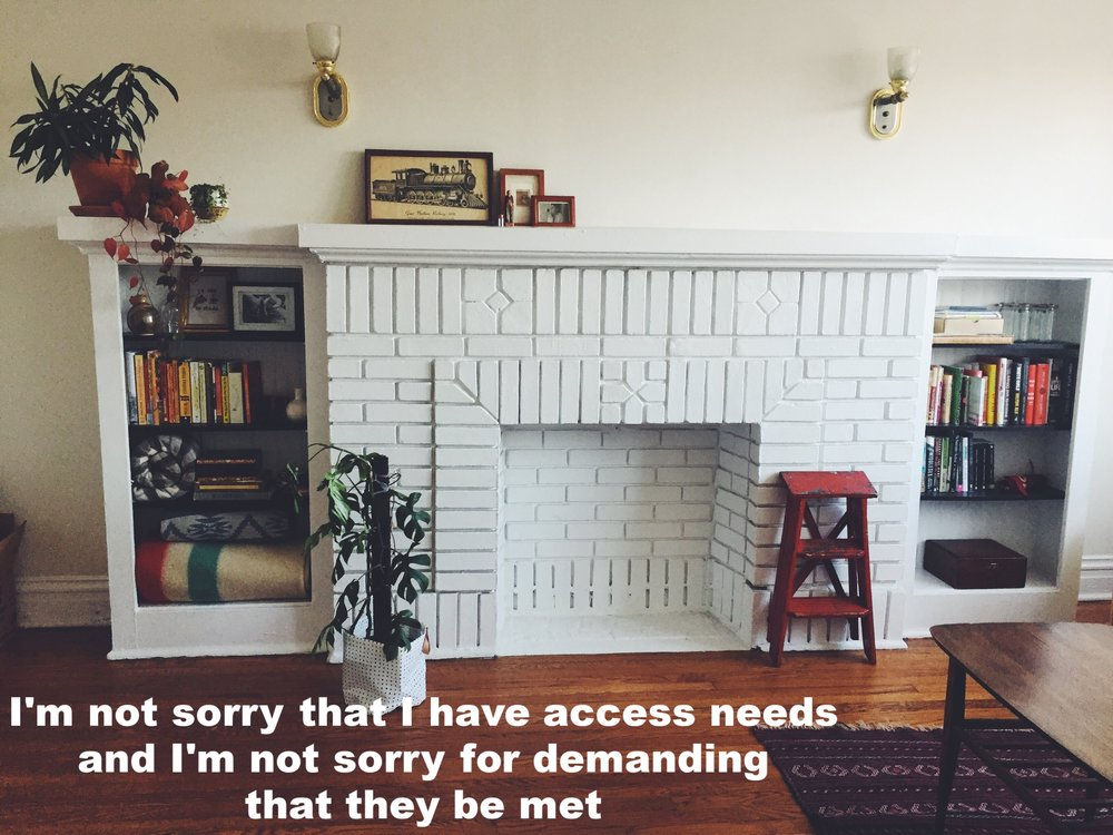 "Elizabeth March 30 2017 Image of a white brick fireplace flanked by bookshelves filled with books, photographs, and knick knacks. ""I'm not sorry that I have access needs and I'm not sorry for demanding they be met"" is overlaid."