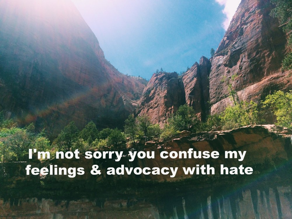 """Jes June 5 2017 Walls of mountains frame the picture, with blue sky above.There are two upside-down rainbows cutting across the image.""""I'm not sorry you confuse my feelings & advocacy with hate. It isn't my fault you don't have a framework of justice and equity"""" is overlaid."""