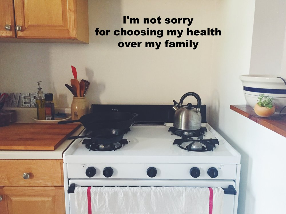 """Anonymous May 24 2017 Image of a small gabs stove with two pots and kettle on it. A white and red striped towel hangs on it's front. """"I'm not sorry for choosing my health over my family"""" is overlaid."""