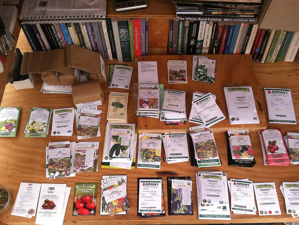 Round three of the seeds comes in. Our seed bins are overflowing, and it feels good: there's so much promise! / The difficulty of farming must, I now observe, self-select the short-of-memory or the native optimist. Because I'm so excited for next year, and it's going to be great! :)