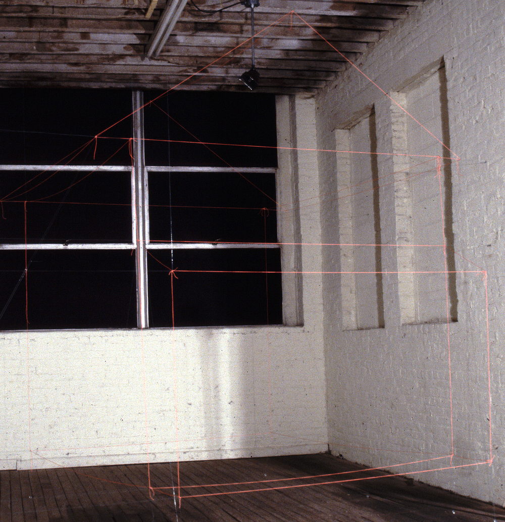 (isolated installation view)    4023 Rosemont Avenue       1999   orange construction site string, monofilament, aluminum anchors    dimensions vary