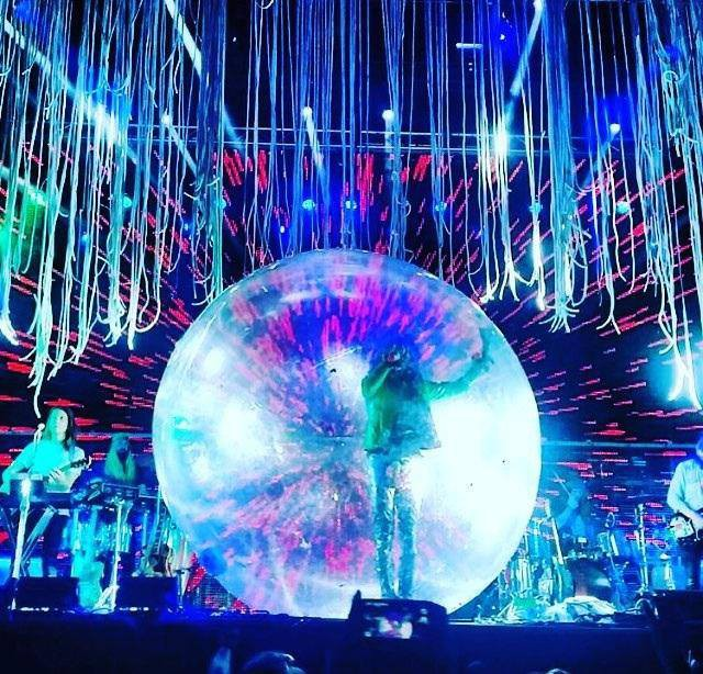 Wayne Coyne within the human-sized hamster ball. Photo courtesy of San Antonio Current.