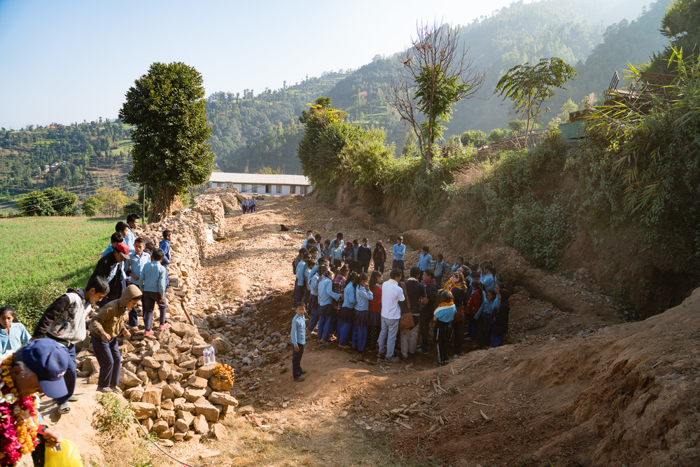 Stone laying ceremony for a new school in the mountians that was destroyed by the earthquake.
