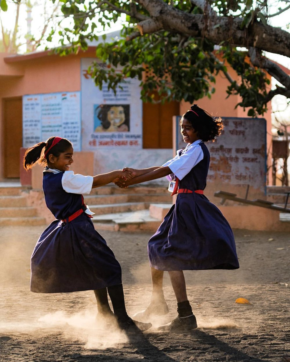 I strive to create photographs that illustrate the joys of life no matter how mundane or small. School girls playing at recess captured while on assignment in India for  Abbott