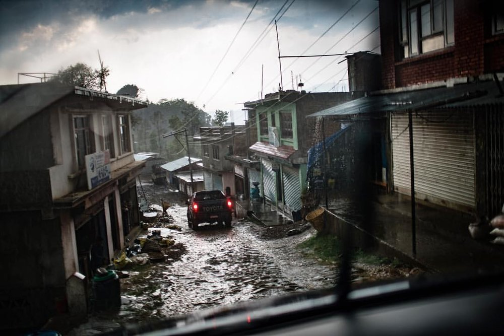 You really have to have a reason to be someplace up in the mountains around Kathmandu. The roads are more like river beds and in the rain that is exactly what they are. I was traveling with doctors from  Americares  in a raging storm doing follow up visits of patients in remote villages. The roads were terrible, but at least this time I wasn't freaked out about my driver being extremely cross eyed. That is another story from a previous trip into the mountains