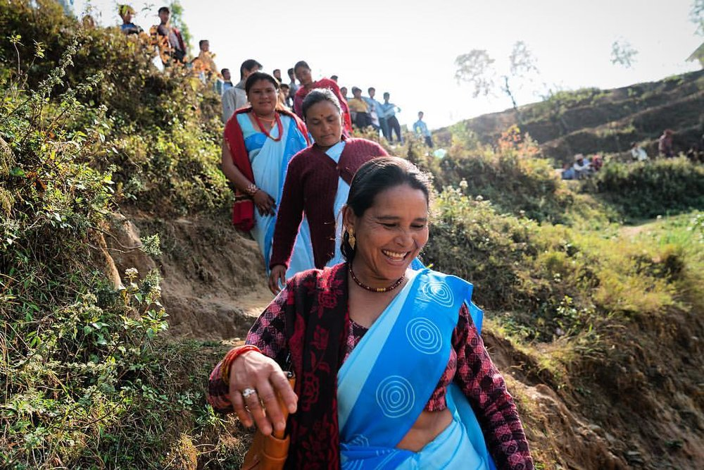 "In the mountains of Nepal you are always climbing up or climbing down. I was with a group of women who are social workers for  Americares . We were climbing down a very steep hill. I was in front. When I got to the bottom I offered my hand to help the woman behind me. She laughed at me. She said ""we are mountain women"" true that! She could probably carry me down and up that hill in sandals no less."
