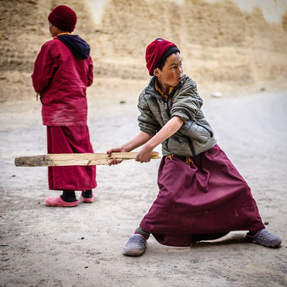 Leaving a monastery in the Ladakh region of India, and we run into these guys. Apprentice monks, they were fun to watch aggressive, a homemade cricket bat, talking smack. So serious about their cricket game. Love the moment.