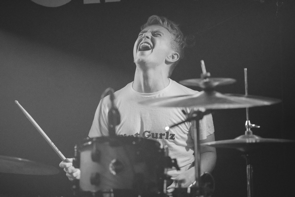 Sean Munro is a drummer based in Edinburgh. Currently playing in three bands with  Hinks ,  Coldsville  and  The Industry , Sean is very experienced having played all over the UK including touring, festivals and playing incredible venues such as the Usher Hall in Edinburgh. He has also recored on many releases including two singles with Hinks and more with The industry. His energy given on stage is second to none and will always leave you wanting more.