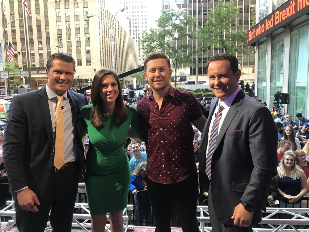 "Scotty McCreery hangs out with the ""FOX and Friends"" anchors in-between performances on the June 2, 2017.  Pictured left to right: ""FOX & Friends"" anchors Pete Hegseth and Abby Huntsman, McCreery, and ""FOX and Friends"" anchor Brian Kilmeade.   (Photo Credit: Scott Stem)"