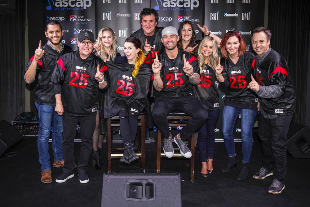 "Brett Young and his team celebrate his 3rd consecutive No. 1 for ""Like I Loved You"" at Nashville Underground Feb. 12. Photo Credit: Ed Rode     Pictured (L-R): Back Row - BMLG Records' Andrew Thoen, Leah Fisher, Scott Borchetta, Lauren Longbine;  Front Row - BMLG Records' Jimmy Harnen, Jesse Lee, Brett Young, BMLG Records' Liz Santana, Michelle Kammerer, Matthew Hargis"