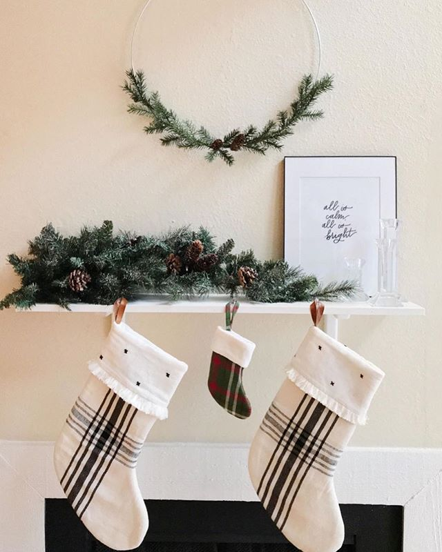 Happy Saturday! Enjoying this festive view with TCU football on the TV ✌🏼 I kept our Christmas decor simple with black, white, and greenery. I love the mix-and-match plaid and tiny peek of red from the puppy's stocking 🐶 Anyone else secretly enjoy the challenge of decorating a smaller space for the holidays? 🙋🏼‍♀️🎄