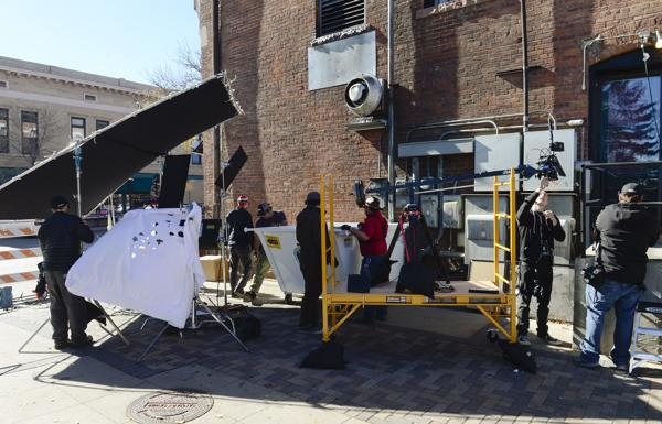 The set of a movie in the east alley near Third Avenue in downtown Longmont on Tuesday.  (Lewis Geyer / Longmont Times-Call)