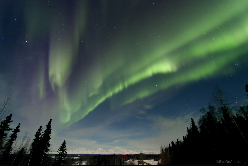 Aurora curtains over the Alaska Range.