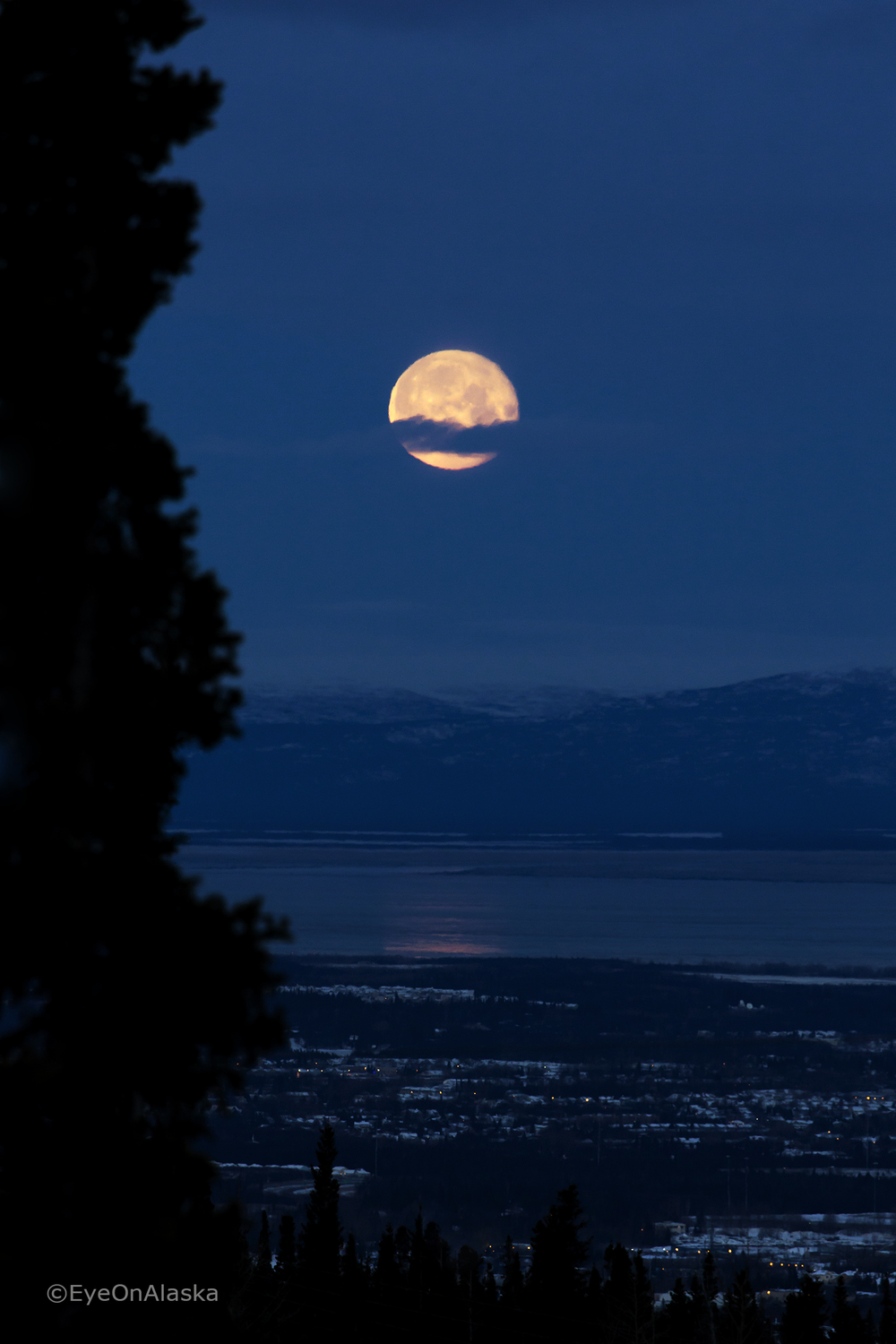 Moon setting behind Anchorage.