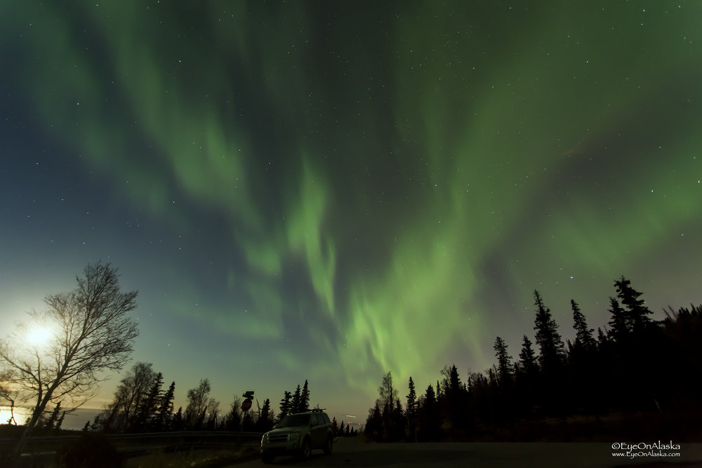 Top of Heights Hill looking the other direction towards Anchorage. Aurora and a 3/4 moon slowly setting.