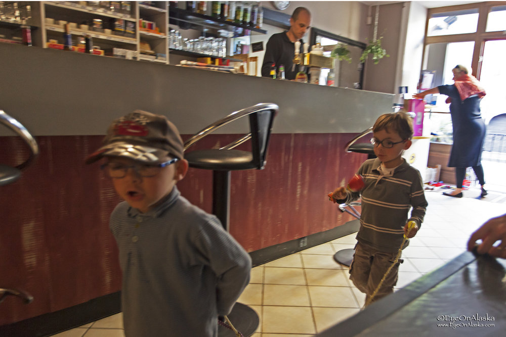 Our little buddies at the local bar.  Nathan and his pals playing train.  I showed them how to fold paper airplanes.  I don't think their mother was very happy ;)