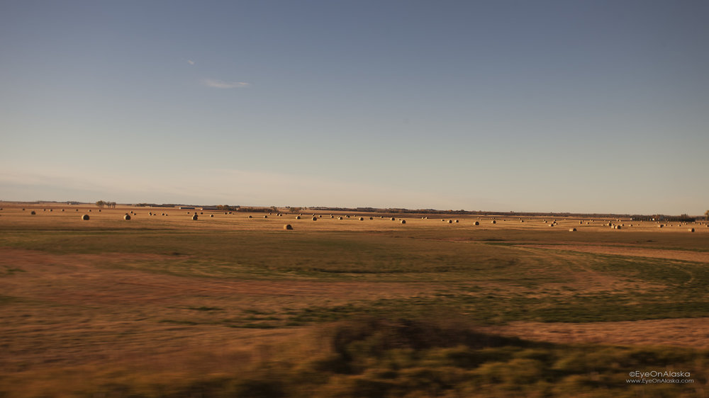 Empty landscapes and big sky, and big hay :)