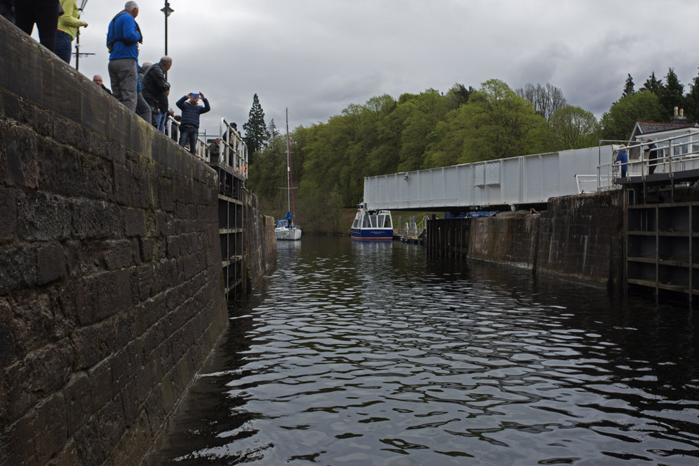 And now it's our turn to head up.  We've made it through the swing bridge and into the first lock.  As they fill each lock, we physically will pull our boat into the next lock—no motors—and on up the flight of 5.  It will take us about an hour and a half to make it.
