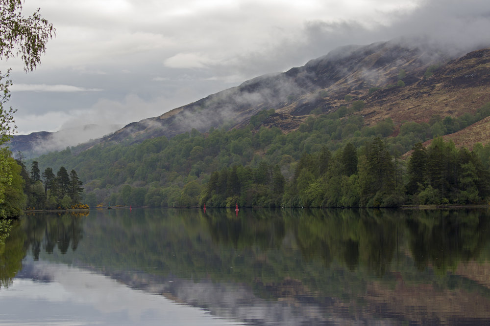 Sunrise on Loch Oich.  Not a ripple as we had our tea and coffee before heading out.  None of the locks or swing bridges open before 8am, so there's not much of a hurry to get going.
